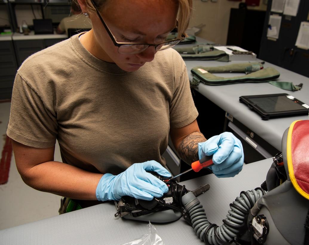 Senior Airman repairs a mask