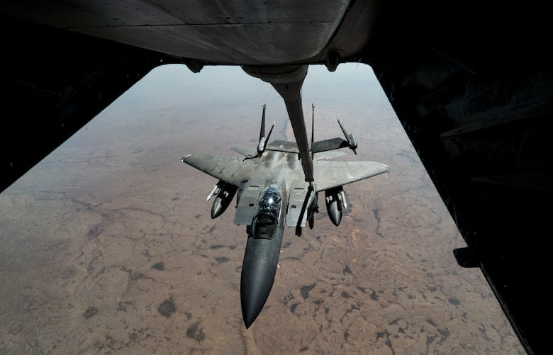 An F-15E Strike Eagle receives fuel from a KC-10 Extender