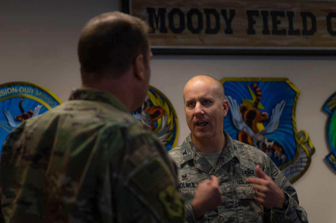 A photo of two Airmen talking