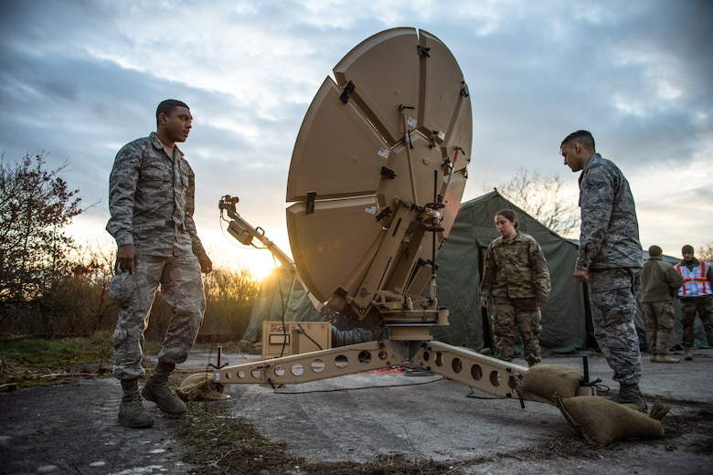 U.S. Airmen assigned to the 1st Combat Communications Squadron adjust a satellite dish during exercise Heavy Rain in Grostenquin, France, Jan. 15, 2020. The 1st CBCS technicians provided the 435th Security Forces Squadron with electronic warfare scenarios to bolster their capabilities in a contested communications environment while sharpening their own skills on spectrum interference. (U.S. Air Force photo by Staff Sgt. Devin Boyer)