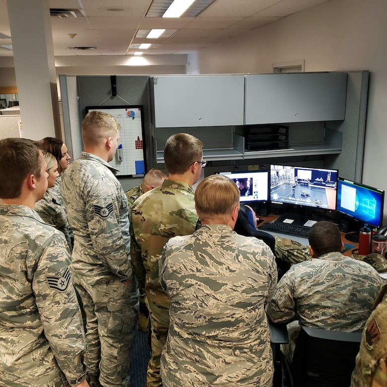 Members of Kervick's Communications Flight team watch matches throughout the day, supporting their wingman.
