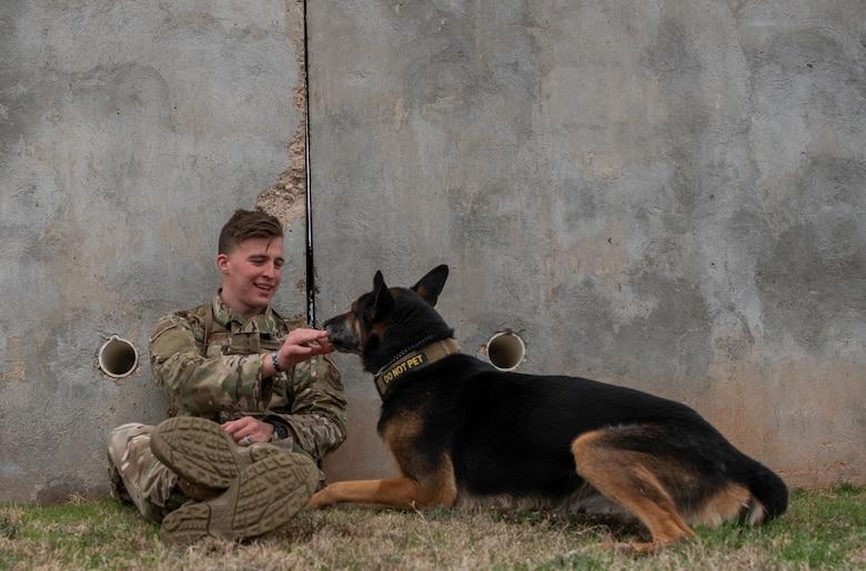 Military working dog handler, and MWD Fix, take a break