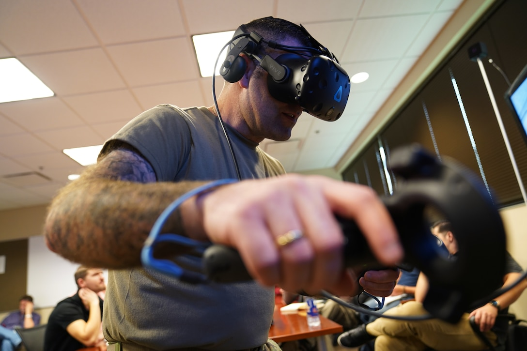 U.S. Air Force Master Sgt. Nathan Cyr, 335th Training Squadron Precision Measurement Equipment Laboratory career field training manager, tests new virtual reality technology inside the Trainer Development Center at Keesler Air Force Base, Mississippi, Jan. 16, 2020. The 335th TRS has introduced a new VR training experience to teach the students in the PMEL career field more efficiently. (U.S. Air Force photo by Airman 1st Class Seth Haddix)
