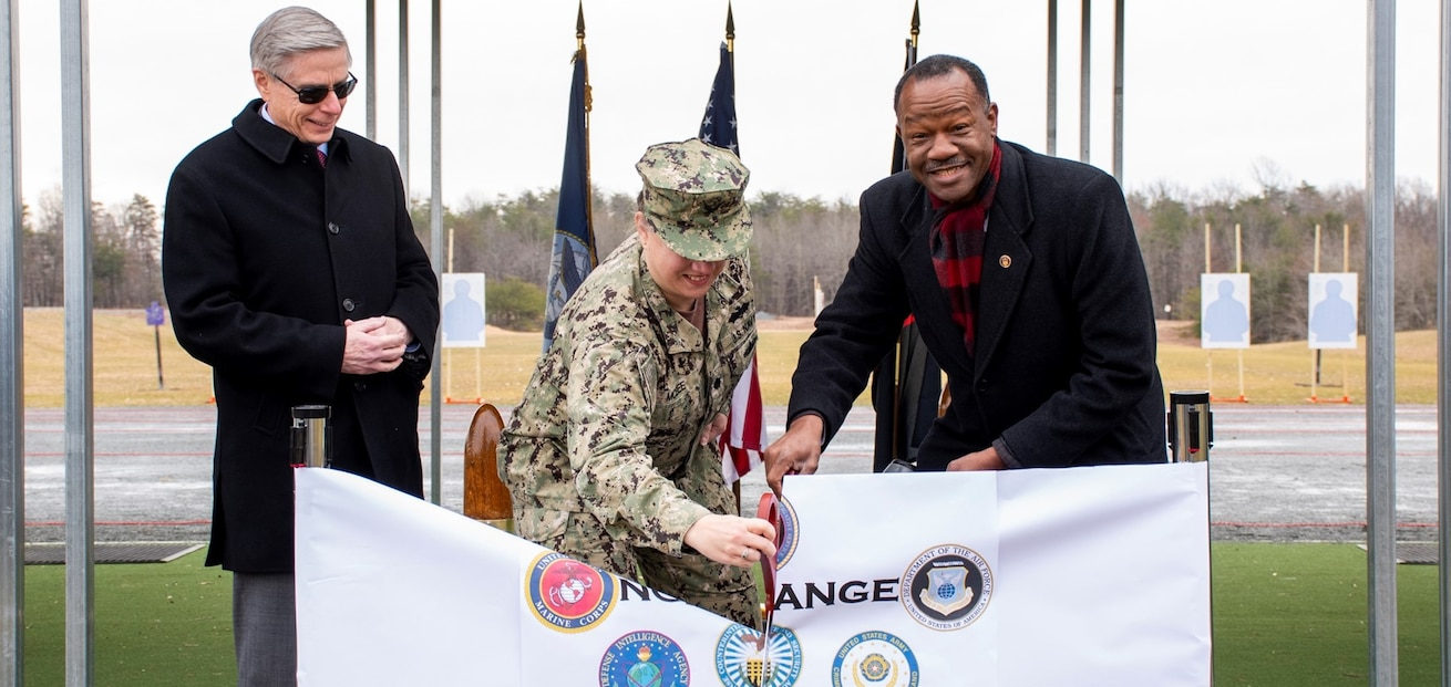 Charles S. Phalen, Jr., Acting Director, Defense Counterintelligence and Security Agency (left), Cmdr. Angelique McBee, Marine Corps Base, Public Works Officer (center) and Mark Russ, Naval Criminal Investigative Service Deputy Director of Operational Support cut a ribbon during a ceremony for the grand opening of the new NCIS firing range.