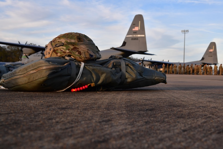 Soldiers from the 4th Brigade Combat Team (Airborne), 25th Infantry Division, at Joint Base Elmendorf-Richardson, Alaska, prepare their gear prior to boarding a C-130J Super Hercules during the joint forcible entry and airborne assault which kicked off Green Flag Little Rock 20-03.