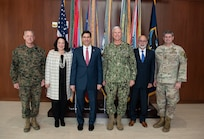 Defense Secretary Dr. Mark T. Esper poses for a photo with military personnel.