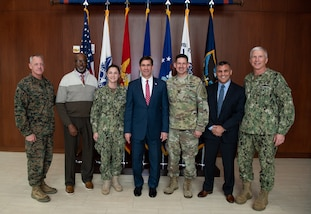 Defense Secretary Mark T. Esper takes a photo with SOUTHCOM service members and civilians after presenting them with a SecDef coin during his visit to the SOUTHCOM Headquarters, in Doral, Fl., Jan. 23, 2020.