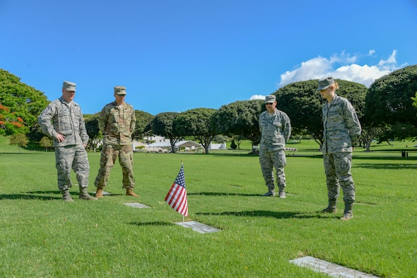 Members of the 134th Air Refueling Wing pause for a moment with Airman Haley Howard at the grave of her great uncle Private 1st Class Henry Durwood Howard in the National Memorial Cemetery of the Pacific in Honolulu, Hawaii. Private Howard was killed in World War Two and few of his family have been able to visit his grave since he was buried in 1944. Airman Howard was in Hawaii on a deployment for training with the 134th Air Refueling Wing out of Knoxville, Tennessee.