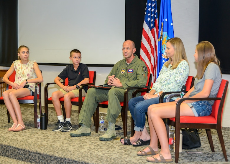 """412th Test Wing Commander, Brig. Gen. E. John Teichert is joined by his wife, Dr. Melonie Teichert, and their children, Tiffany, Noah and Summer, during the live-streamed """"Talk with Team Teichert"""" Q-and-A session at the Airmen and Family Readiness Center on Edwards Air Force Base, California, Sept. 4, 2019. The Teicherts answered questions about military life and family life on base. (U.S. Air Force photo by Giancarlo Casem)"""