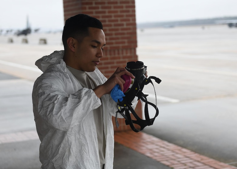 An Airman puts on a gas mask.