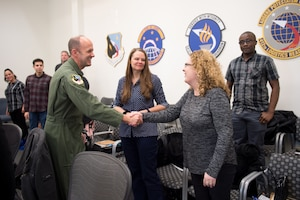 Brig. Gen. E. John Teichert, 412th Test Wing Commander, welcomes newly-hired Air Force Civilian, Joy Stanton to Team Edwards during a civilian new employee orientation event at Edwards Air Force Base, California, Jan. 6, 2020. (U.S. Air Force photo by Richard Gonzales)