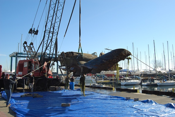 """Recovery of Vought F4U-1 """"Birdcage"""" Corsair Fighter, Nov. 8, 2010. (Photo courtesy of A and T Recovery)."""