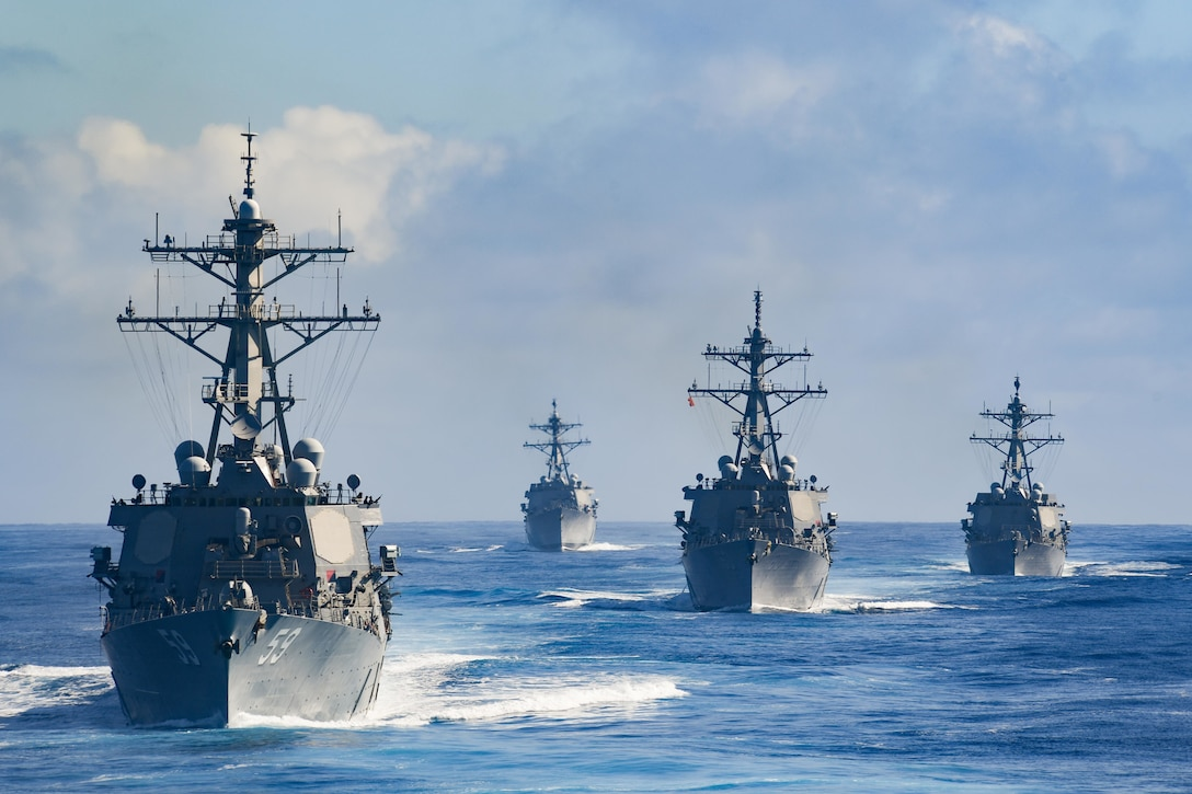 Four ships sail the Pacific Ocean.
