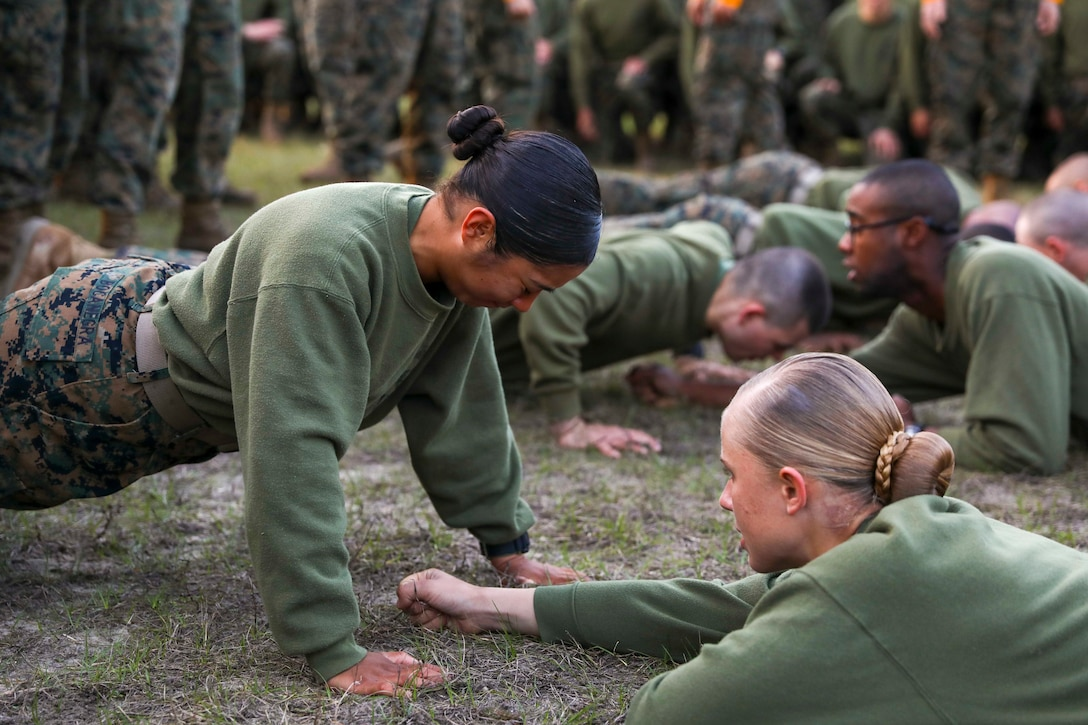 A group of Marines perform pushups.