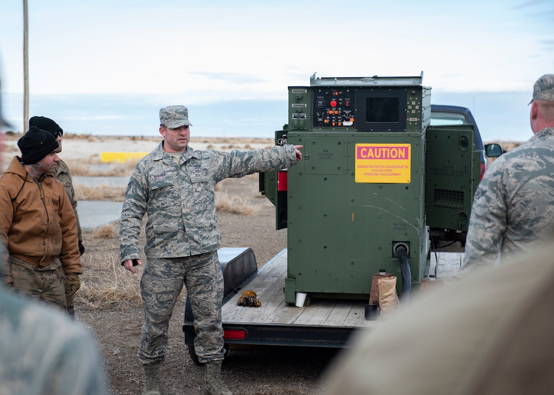 Tech. Sgt. Christopher Archer, 366th Civil Engineer Squadron electrical power production craftsman, teaches Airmen how to use a power generator during a multi-capable Airman training, Jan. 23, 2020, at Mountain Home Air Force Base, Idaho. This training was conducted to equip Airman with skills from other career fields to enhance their readiness. (U.S. Air Force photo by Senior Airman Tyrell Hall)