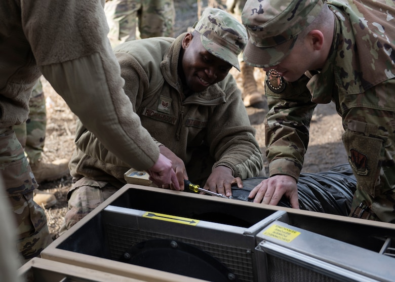 Staff Sgt. David Richardson, 366th Civil Engineer Squadron, learns how to assemble a heating, ventalation and air-conditioning unit during a multi-capable Airman training, Jan. 23, 2020, at Mountain Home Air Force Base, Idaho. This training was conducted to equip Airman with skills from other career fields to enhance their readiness. (U.S. Air Force photo by Senior Airman Tyrell Hall)