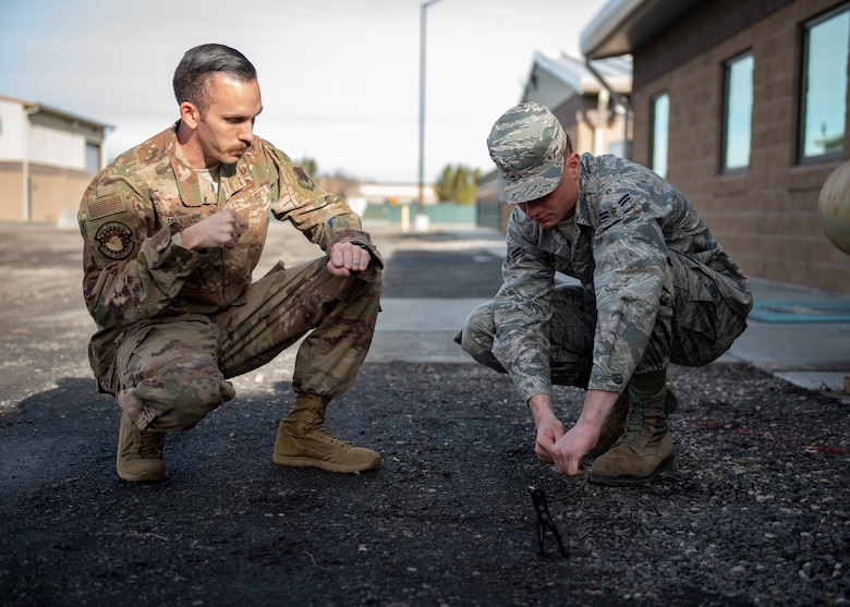 Staff Sgt. David Felkins, 366th Civil Engineer Squadron explosives ordinance disposal technician, teaches an Airman how to conduct a time fuse burn test, Jan. 23, 2020, at Mountain Home Air Force Base, Idaho. These fuses are used by explosive ordinance disposal technicians to build counter-detonation explosives downrange. (U.S. Air Force photo by Senior Airman Tyrell Hall)