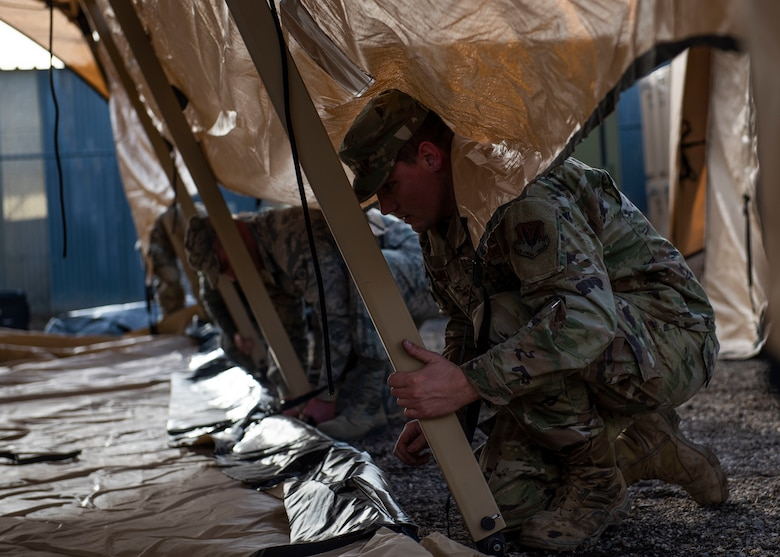 Airmen from the 366th Civil Engineer Squadron set up a Rapid Deployment Tactical Military Shelter during their multi-capable Airman training, Jan. 23, 2020, at Mountain Home Air Force Base, Idaho. The shelter is made of durable material and can withstand winds up to 60 mph. (U.S. Air Force photo by Senior Airman Tyrell Hall)