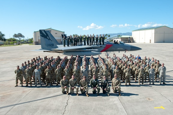 During the final day of Sentry Aloha 20-1, which is a fighter integration training exercise held at Joint Base Pearl Harbor-Hickam, Hawaii, 120 Airmen from the 144th Fighter Wing stand in formation for a group photo with an F-15C Eagle.