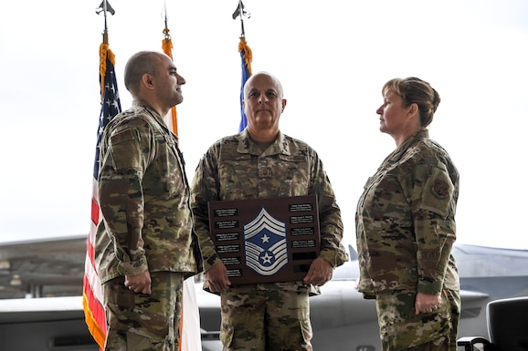 Chief Master Sgt. Lorene Kitzmiller accepts new responsibilities during an assumption of authority ceremony held at Fresno Air National Guard Base, California, as she becomes Command Chief of the 144th Fighter Wing Dec. 7, 2019