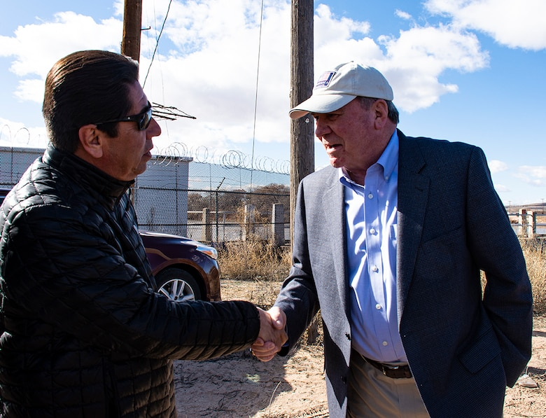 Albuquerque, N.M. -- R.D. James, assistant secretary of the Army for civil works, shakes hands with Richard Jaramillo, 2nd Lt. Gov., Pueblo of Isleta, during James' visit to U.S. Army Corps of Engineers-Albuquerque District Jan. 22.  James discussed the Middle Rio Grande Bernalillo to Belen Flood Protection project, which will protect Pueblo lands when completed.