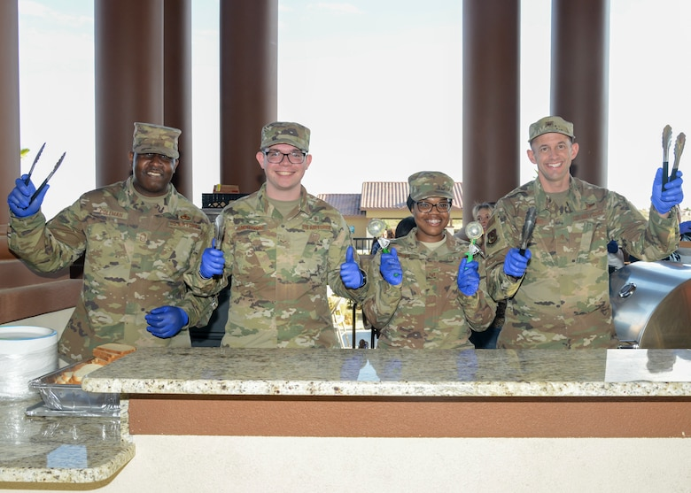 Chief Master Sgt. James Coleman, 412th Test Wing acting command chief, Airman 1st Class Cameron Hawthorne, 412th Aerospace Medicine Squadron, Staff Sgt. Akina Jones, 412th AMDS, and Brig. Gen. E. John Teichert, 412th TW commander, pose for a photo during a Strong Family Program event at the Mojave Sky Community Center at Edwards Air Force Base, California, March 18, 2019. (U.S. Air Force photo by Giancarlo Casem)