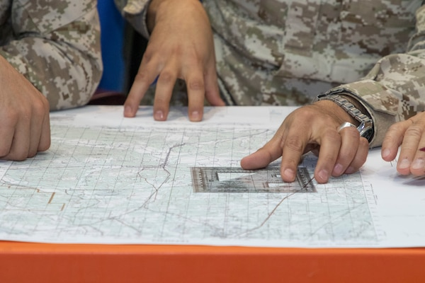 Jordan Armed Forces-Arab Army (JAF) Soldiers use a map protractor to plot points during a Map Reading Subject Matter Expert Exchange with Military Engagement Team-Jordan, 158th Maneuver Enhancement Brigade, Arizona Army National Guard, at a base outside of Amman, Jordan Jan. 13, 2020. The United States will protect our people and interests anywhere they are found around the world and is committed to the security of Jordan and to the partnering closely with the JAF to meet common security challenges. (U.S. Army photo by Sgt. 1st Class Shaiyla B. Hakeem)
