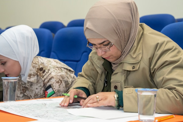 A Jordan Armed Forces-Arab Army (JAF) Quick Reaction Force Female Engagement Team Soldier use a map protractor to plot points during a Map Reading Subject Matter Expert Exchange with Military Engagement Team-Jordan, 158th Maneuver Enhancement Brigade, Arizona Army National Guard, at a base outside of Amman, Jordan Jan. 13, 2020. The United States will protect our people and interests anywhere they are found around the world and is committed to the security of Jordan and to the partnering closely with the JAF to meet common security challenges. (U.S. Army photo by Sgt. 1st Class Shaiyla B. Hakeem)
