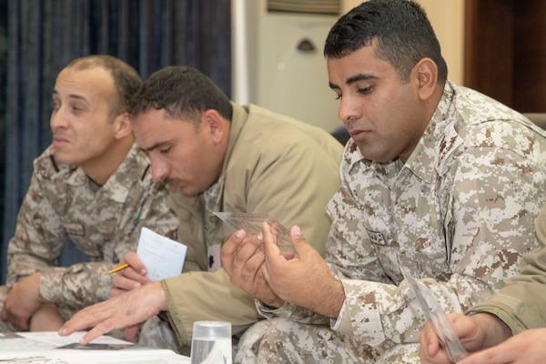 Jordan Armed Forces-Arab Army (JAF) Soldiers examine map protractors during a Map Reading Subject Matter Expert Exchange with Military Engagement Team-Jordan, 158th Maneuver Enhancement Brigade, Arizona Army National Guard, a base outside of Amman, Jordan Jan. 13, 2020. The United States will protect our people and interests anywhere they are found around the world and is committed to the security of Jordan and to the partnering closely with the JAF to meet common security challenges. (U.S. Army photo by Sgt. 1st Class Shaiyla B. Hakeem)