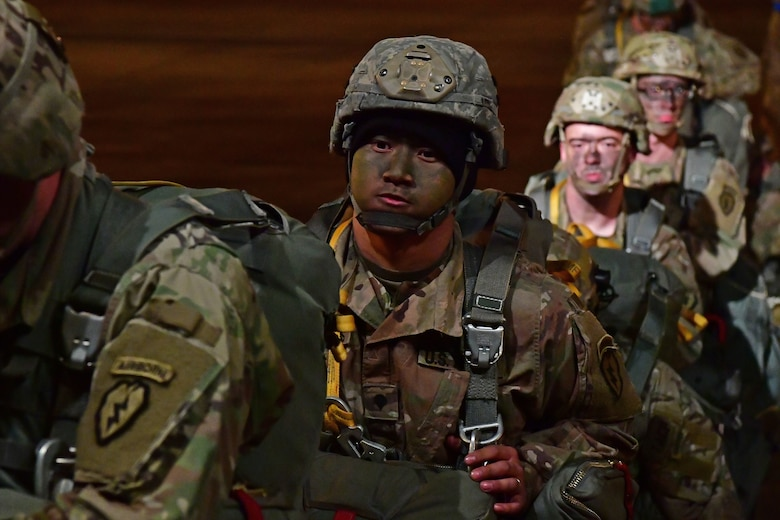 Soldiers from the 4th Brigade Combat Team (Airborne), 25th Infantry Division, at Joint Base Elmendorf-Richardson, Alaska, board a C-130J Super Hercules during the joint forcible entry and airborne assault.