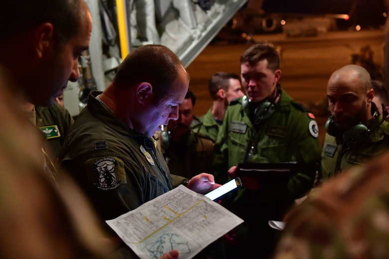 A pilot from the 61st Airlift Squadron gives a pre-flight mission brief on the back of a C-130J Super Hercules during the joint forcible entry and airborne assault which kicked off Green Flag Little Rock 20-03.