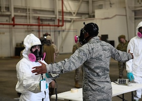 U.S. Air Force Senior Airman Jajuan Erby, 19th Medical Group bioenvironmental technician, is inspected for simulated radiation during a radiological aircraft recovery training exercise at Little Rock Air Force Base, Arkansas, Jan. 23, 2020. The decontamination line allows for any member who has possibly been exposed to radiation to be safely checked then decontaminated. (U.S. Air Force photo by Airman 1st Class Jayden Ford)
