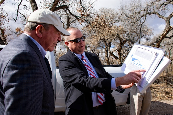 Albuquerque, N.M. -- Ryan Gronewold, planning branch chief, USACE-Albuquerque District, briefs a civil works levee project to R.D. James, assistant secretary of the Army for civil works, during his visit, Jan. 22. James met with project sponsors and key stakeholders to discuss civil works projects in the Middle Rio Grande region including the Bernalillo to Belen Flood Protection and Sandia to Isleta Ecosystem Restoration.