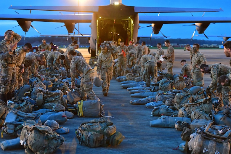 Soldiers from the 4th Brigade Combat Team (Airborne), 25th Infantry Division, at Joint Base Elmendorf-Richardson, Alaska, wait to board a C-130J Super Hercules during the joint forcible entry and airborne assault.