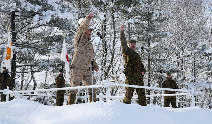 Col. Jason Perry (Left), the commanding officer of 4th Marine Regiment, 3rd Marine Division, and Maj. Gen. Kose, the commanding officer of 5th Brigade, Japan Ground Self-Defense Force, chant with the forces during an opening ceremony to start off exercise Northern Viper on Hokudaien Training Area, Hokkaido, Japan, Jan. 26, 2020. Northern Viper is a regularly scheduled training exercise that is designed to enhance the interoperability of the U.S. and Japan Alliance by allowing infantry units to maintain their lethality and proficiency in infantry and combined arms tactics. (U.S. Marine Corps Photo By Cpl. Cameron E. Parks)