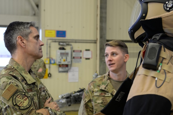 U.S. Air Force Lt. Gen. Steven Basham, U.S. Air Forces in Europe-Air Forces Africa deputy commander, left, connects with Staff Sgt. Michael Long, 786th Civil Engineer Squadron explosive ordnance disposal craftsman, in a hangar during a base tour of Ramstein on Jan. 17, 2020. Long showed Basham some of the latest gear used by the EOD team and shared some of the history behind the equipment. (U.S. Air Force photo by Airman 1st Class Daniel Sanchez)