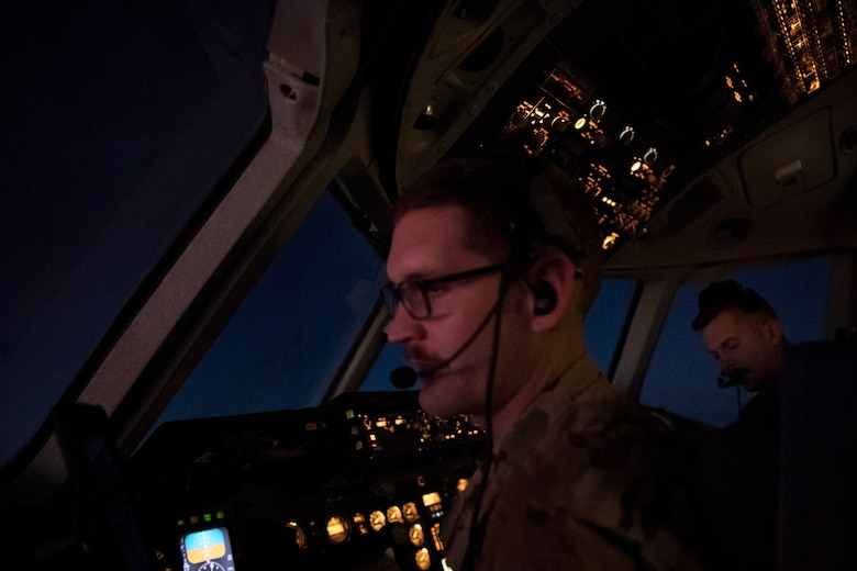 U.S. Air Force KC-10 Extender pilots assigned to the 908th Expeditionary Air Refueling Squadron adjust aircraft settings above the U.S. Central Command area of responsibility, Jan. 11, 2020.