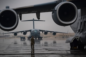 A U.S. Air Force flying crew chief assigned to the 816th Expeditionary Airlift Squadron conducts preflight checks of a U.S. Air Force C-17 Globemaster III at Al Udeid Air Base, Qatar, Jan. 10, 2020.