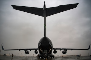 U.S. Air Force Airmen assigned to 746th Expeditionary Logistics Readiness Squadron load cargo into a C-17 Globemaster III assigned to the 816th Expeditionary Airlift Squadron at Al Udeid Air Base, Qatar, Jan. 10, 2020.