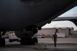 A U.S. Air Force KC-10 Extender flight engineer assigned to the 908th Expeditionary Air Refueling Squadron conducts preflight checks at Al Dhafra Air Base, United Arab Emirates, Jan. 11, 2020.