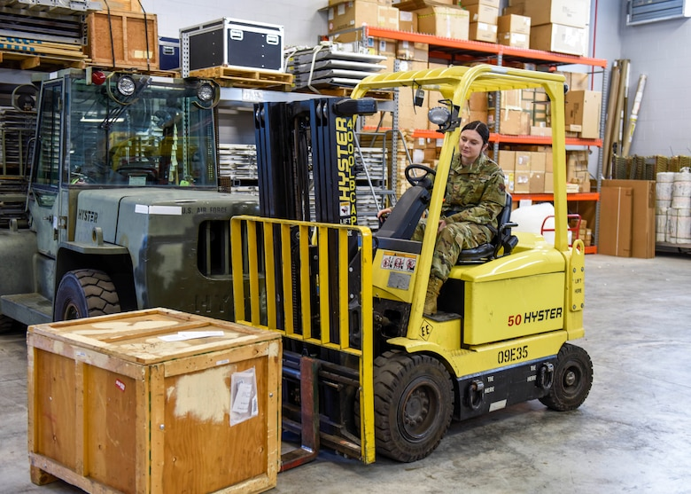 U.S. Air Force Staff Sgt. Raven Driftmyer, a traffic management specialist assigned to the Ohio Air National Guard's 180th Fighter Wing, uses a forklift to move a crate in the receiving warehouse at the Toledo Air National Guard Base, Ohio, Jan. 12, 2020. The Traffic Management Office is responsible for processing and managing moving cargo, shipments and Airmen around the world, as well as receiving supplies for the base, ensuring the Air Force can fulfill its mission anywhere in the world. (U.S. Air National Guard Photo by Senior Airman Kregg York)