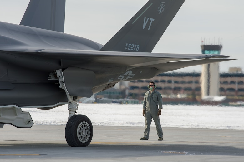 A U.S. Air Force crew chief, assigned to the 158th Fighter Wing's Maintenance Group, Vermont Air National Guard, prepares an F-35 Lightning II for departure from the Burlington Air National Guard Base, Vermont, Vt., Jan. 23, 2020. More than 100 158th FW Airmen traveled to Eglin Air Force Base, Florida, to participate in a training event, titled Southern Lightning, to support flying operations and develop their skills during the training. (U.S. Air National Guard photo by Miss Julie M. Shea)