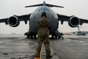 A U.S. Air Force C-17 Globemaster III loadmaster assigned to the 816th Expeditionary Airlift Squadron performs engine start checks at Al Udeid Air Base, Qatar, Jan. 10, 2020.