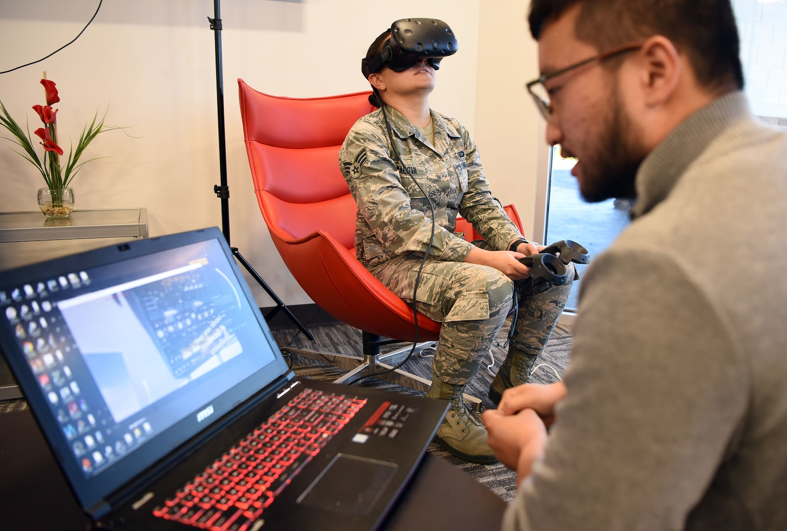 Senior Airman Alzara Kimalova, Air Force Sustainment Center contract specialist, is walked through power-off procedures for C-130H aircraft through virtual reality technology at the Inaugural Pitch Day hosted by the Robins Spark Cell and AFSC Contracting located at Robins Air Force Base, Sept. 20, 2019, at the Advanced Technology and Training Center in Warner Robins, Georgia. The event is an initial prototype effort to assess the capabilities of current commercially available virtual reality training systems when used in a military environment, particularly within the 461st and 116th Air Control Wings at Robins.