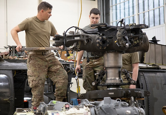 Army Maintainers repair rotor spindle assemblies on aircraft
