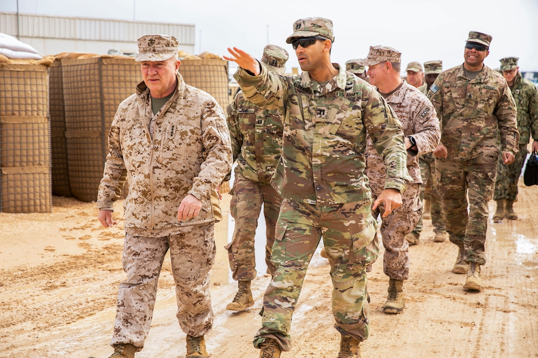 U.S. Marine Corps Gen. Kenneth F. McKenzie Jr., the commander of U.S. Central Command (USCENTCOM), left, walks with Soldiers assigned to 3rd Battalion, 4th Air Defense Artillery Regiment, Jan. 24, 2020. McKenzie visited the USCENTCOM Area of Responsibility to discuss security and stability in the region with forward deployed service members. (U.S. Marine Corps photo by Sgt. Roderick Jacquote)