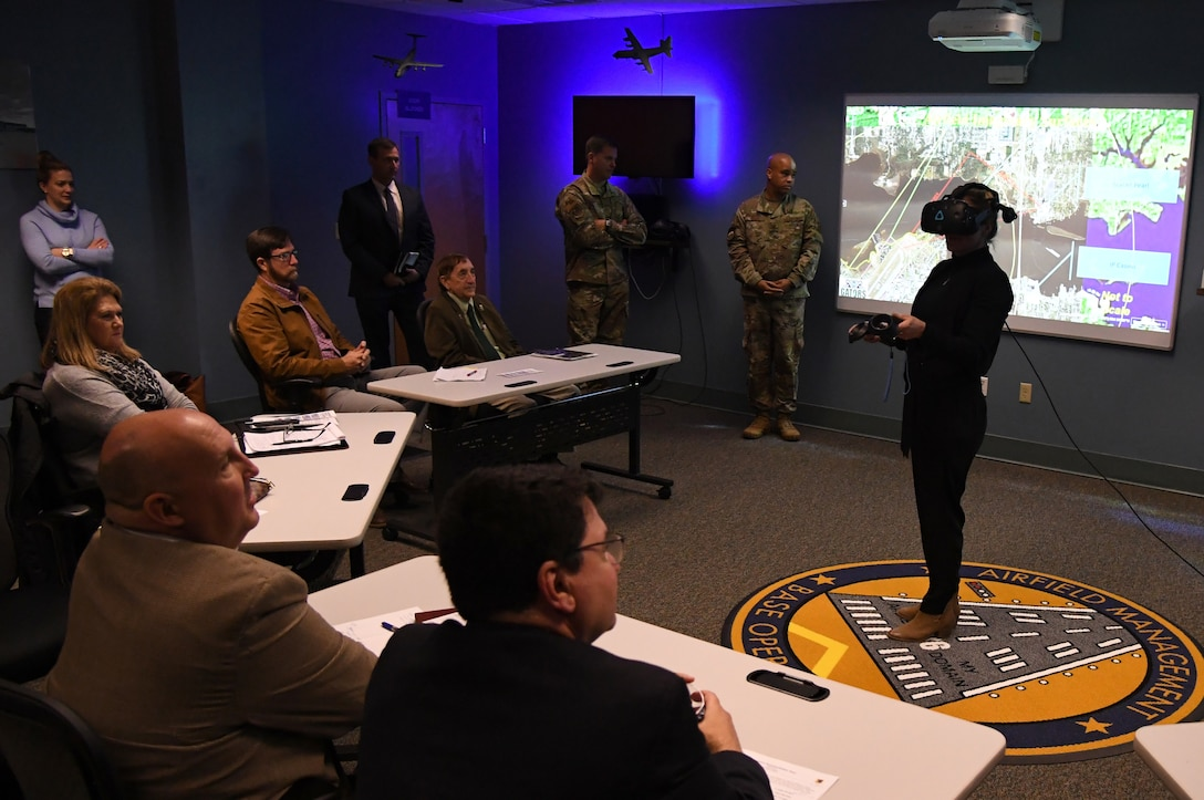 Leslie Robertson, D'Iberville project coordinator, participates in an airfield management virtual reality demonstration during the airspace sustainability tour inside Cody Hall at Keesler Air Force Base, Mississippi, Jan. 23, 2020. Keesler hosted the community engagement for civic leaders to discuss Keesler's flying mission requirements in order to create processes which inform key decision makers regarding local development, and to ensure compatible economic growth for the surrounding communities. (U.S. Air Force photo by Kemberly Groue)