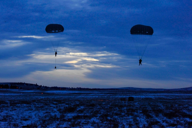 SERE Airmen drop from aircraft