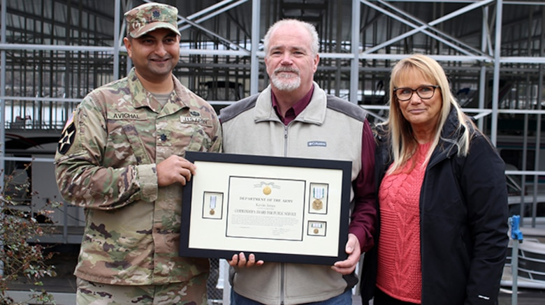 Lt. Col. Sonny B. Avichal, U.S. Army Corps of Engineers Nashville District commander, poses with Kevin and Donna Jones Jan. 24, 2020 at Wildwood Resort and Marina at Cordell Hull Lake in Granville, Tennessee. The commander presented the Department of the Army Commander's Award for Public Service for his actions to rescue a patron whose vehicle entered the water at the boat ramp Aug. 5, 2019. (USACE photo by Ashley Webster)