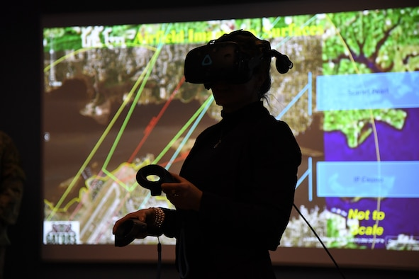 Leslie Robertson, D'Iberville, Mississippi, project coordinator, participates in an airfield management virtual reality demonstration during the airspace sustainability tour inside Cody Hall at Keesler Air Force Base, Mississippi, Jan. 23, 2019. Keesler hosted the community engagement for civic leaders to discuss Keesler's flying mission requirements in order to create processes which informs key decision makers regarding local development and to ensure compatible economic growth for the surrounding communities. (U.S. Air Force photo by Kemberly Groue)